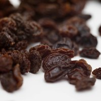 Dried purple raisins may become shriveled and dry in the box, but plumping them up is easy to do..