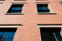 Steel lintels should be installed when the doorway or window opening is being constructed.