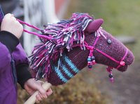 Stick horses can be customized for each rider by using different colored socks, fabrics and yarn.