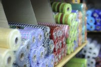 Wide fabric suitable for sheets is sometimes sold for quilt backings.