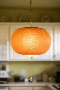 Create a hanging lamp from a basket or inexpensive lampshade.
