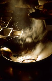Easily remove rust from your wok with salt and vegetable oil.