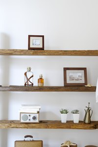 Cut your wood shelves to sit flush to your wall.