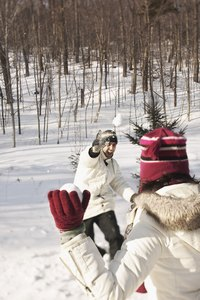 Make a pair of knit gloves to keep your hands warm while you are playing in the snow.