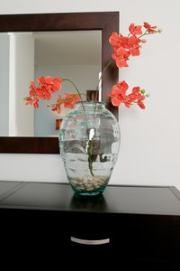 Clear vases can decoratively display a full range of objects.