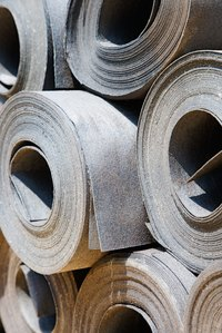 Rolls of roofing felt.
