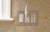 The buttons on these outlets indicate they are GFCI outlets, required in kitchens.