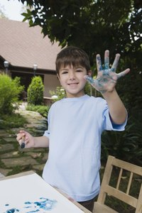 A child's handprints on canvas gives the craft a polished and professional look.