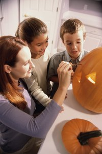 Carve a pumpkin with friends as a Halloween tradition.