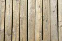 Bare wooden planks accentuate natural colors in a yard.