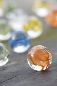 Recycle marbles into a colorful fashion necklace.