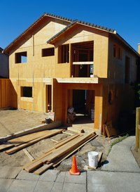 Siding on a house goes up faster with a nail gun.
