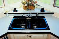 Corner kitchen sink cabinets are generally larger than other base cabinets.