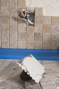 Use grout between tiles and silicone at the edges of the shower.