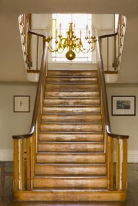 Restore the gleaming look of your stair treads by sanding off the old finish and re-staining each one.