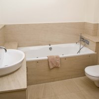 Caulking around bathtubs keeps moisture out of walls and floors.