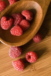 A raspberry fruit is an aggregation of numerous tiny fleshy fruits fused together.