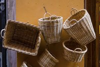 Baskets hung on a wall are decorative and functional.