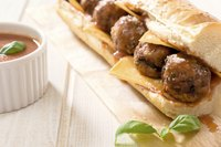 Use cheddar cheese and fresh basil for a different kind of meatball sub sandwich.