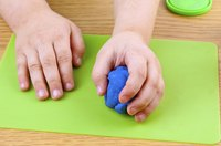 Kneading the Play-Doh will help to soften it.