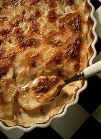 Bake potato gratin until it's warm and bubbly.