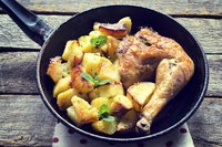 Sear chicken, then bake with potatoes and veggies for a one-pot meal.