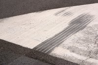 Filling holes, repairing cracks and applying sealer can all help smooth out rough asphalt.
