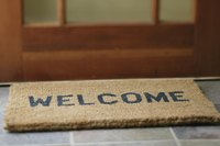 "Paint ""WELCOME"" on natural-fiber coir doormat."