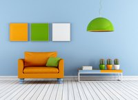 Orange, green and blue create triadic decor here, with white to diffuse the intensity.