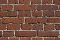 This exterior wall is made of old-style bricks, in a distinctive pattern.