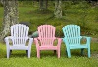 Spray paint plastic chairs that are plain and drab or old and dirty.