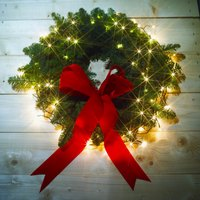 Hang your lighted wreath indoors to add ambiance to holiday decorations.
