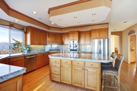New luxurious wood kitchen with cabinets.