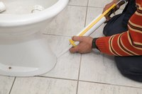 Caulking the base of your AquaSource toilet ensures a watertight seal.