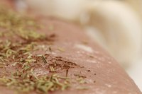 Baste grilled or broiled pork tenderloin to prevent herbs on the surface from scorching.