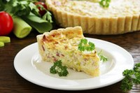 Creamy egg and a crisp crust come together in perfect harmony in even the simplest quiche.