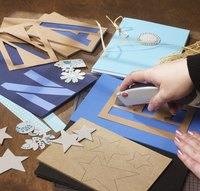 Use handmade stencils to make your own greeting cards.