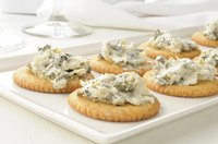 Buttery Ritz crackers provide the perfect complement to boldy flavored spinach dips.