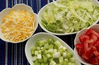 Offer shredded lettuce as a topping for any build-your-own meal.