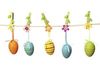 Tie cute ribbons through decorated plastic eggs for Easter decor.