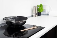 Some types of wok will work on a high-end induction stovetop.
