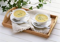 Serve cream of chicken soup with fresh bread or a baguette.