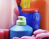 Close-up of cleaning products and rubber gloves.