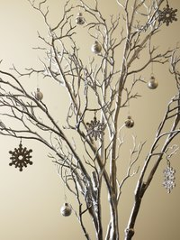 Create a wintry effect with paint and ornaments.