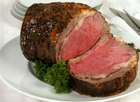 An initial higher oven temperature develops the characteristic crust on a prime rib roast.