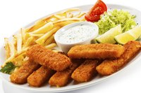 Fish sticks, fries, tartar sauce and lemon wedges make a traditional dish.