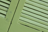 Hinged shutters can enclose a porch when necessary.