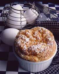 Acids, such as cream of tartar, help stiffen egg whites in soufflé.