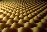 Try the egg crate foam from your mattress as sound-proofing material.