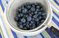 Leave some room in the strainer or colander to swirl the blueberries.